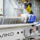 Industrial robot handling valve bags